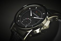Image from http://www.thecoolist.com/wp-content/uploads/2012/04/Schofield-Signalman-2012-Black-Sharkskin-Strap-Angled-3.jpg.