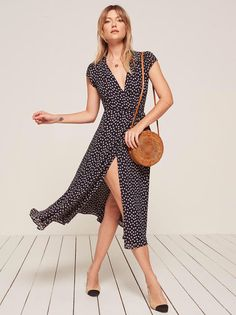 Yet another easy Ref number you probably need. This is a midi length, wrap dress with a high slit, v neckline and a cap sleeve.