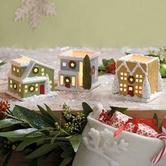 "VILLAGE SQUARE TEALIGHT TRIO : The windows of our quaint, snow-covered cottages glow with the light of a tealight, sold separately. Set includes three hand-painted ceramic houses, each with a tealight dish. 2¾""-3""h. by PartyLite"