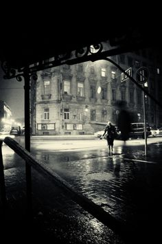 It's dark in the city after midnight. Doesn't stop the continuous path of traffic maneuver through the rain- soaked asphalt. I stand under a bridge waiting for my guy to show up. When a clock shows its nearing one o clock, I start to question if I should leave. I then see him walking towards me, holding a gun level. Not a good sign