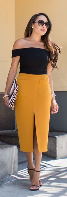 black off the shoulder top with mustard pencil skirt