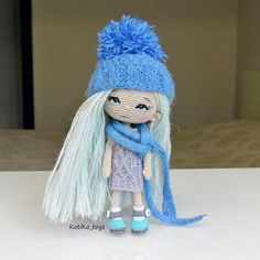 Cute amigurumi doll with pale blue hair and hat and scarf. (Inspiration).