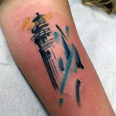 Small Mens Watercolor Lighthouse Tattoo In Blue And Yello Ink