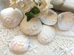 RESERVED FOR JANINE~ Set of 75 Lace Graced Seashells ~ For a Lovely Seaside Tablescape ~ Scatter among candles, driftwood sailboats and flowers for a romantic beach-swept cottage table decor of the most beautiful kind.  I found these lovely clam shells on a rugged beach in Northern California. Each naturally textured in white and cream. Each is embellished, inside and out, with vintage lace and flower appliqués. This listing is for a set of 75 shells. The shells vary in sizes. Those pictured…