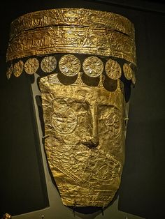 Closeup of a Gold death mask of a high priestess and wife of a Bottiaean ruler Greek 540 BCE Known as the Lady of Archontiko, this wife of a Bottiaean ruler served as high priestess and the incarnation and mediator of divine blessings for her community no