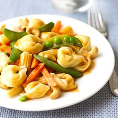 Tortellini Stir-Fry  To make this simple supper, toss packaged tortellini, frozen stir-fry veggies, and cashews with bottled peanut sauce.
