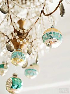 If space is limited, you might not be able to hang every ornament you own on a tree, but there's no reason to keep the leftovers boxed up. Look for unexpected places -- from a chandelier, at a window, over a doorway -- to dangle a few for sparkle and cheer.