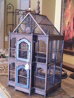 It is just beautiful! Diy Parakeet Cage, Birdcage Light, Bird Cage Design, Vintage Birdcage, Antique Bird Cages, Pet Bird Cage, Hamster Cages, Bird Houses Painted, Bird Aviary