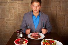 Man at Restaurant Eating Steak