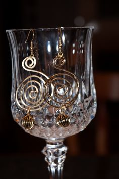 Gold tone wire swirls with metal bead.  See my etsy shop ginasgemsandmore