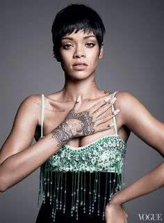 The singer shows off her henna-style hand tattoos. MiuMiu embellished silk dress. Repossi multipiercing earring with diamonds.