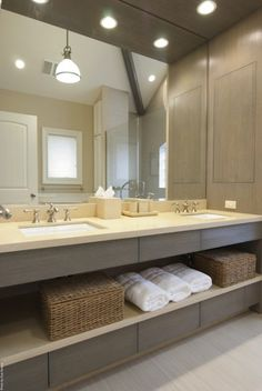 AMI Designs: Gorgeous modern bathroom design with gray modern washstands, woven baskets and stone ...