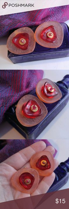 Stacked sea glass clip earrings! Pink red gold This artsy pair of earrings are made of stacked frosted pink and clear red glass ( ??? Exact material unknown) that is secured with a gold tone bead stopper on each. The clip backs are gold tone. This pretty pair is in very nice vintage condition with very light signs if wear. From a smoke free home :)  MOONB8158stack888 Vintage Jewelry Earrings