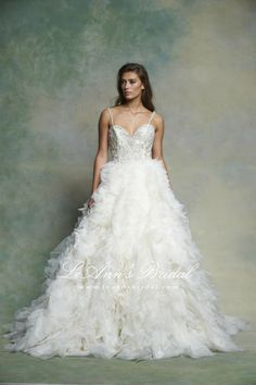 Enaura Bridal Wedding Dress ES563 - This sweetheart ball gown features beaded straps and bodice, a low illusion back, natural waist, and a ruffled organza skirt for a standout look perfect for the glamorous bride.