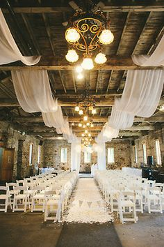 Visually effective white wedding ceremony set in an old building