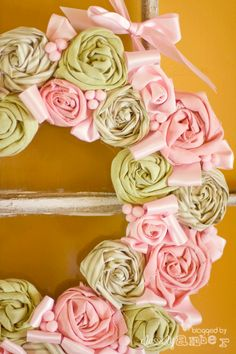 Cute wreath, don't really like the directions how to make it.  Would do it with a wreath form instead & would be quite time consuming to make this many flowers!