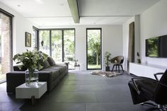 Look inside at a modern house Nibo Stone Sophisticated Living Rooms, Home, Stone Flooring, Contemporary Living Room Design, House Flooring, Living Room Tiles, Tile Floor Living Room, Grey Flooring, Stone Flooring Living Room