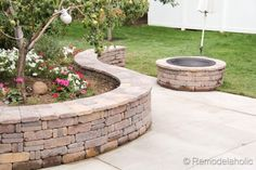 This is such a great tutorial for making a DIY seat wall/flower bed and fire pit from Remodelaholic.