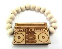 Wooden Boombox Charm Bracelet w/ 10 mm Beads ALL GOOD WOOD STYLE! natural, elastic. 100% natural wood with 10mm beads. One size fits all. Elastic style is easy to wear and fresh!. Precise digital carving on each and every piece. If your order is in before 3pm, it will be out the same day.