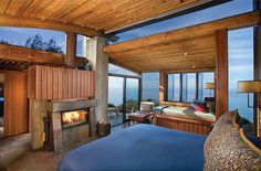 Hotels Near Monterey | Post Ranch Inn - Ocean House | Big Sur Resorts- Become one with nature with these free-standing structures, offering curved, beamed roofs covered with a soft carpet of grass and wildflowers. There are panoramic ocean views from the bed, bath, window seat and terrace.