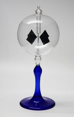 """Radiometer Give a gift he can use!    Blue Tapered Stem Radiometer 2.25"""" Diameter Clear Sphere"""