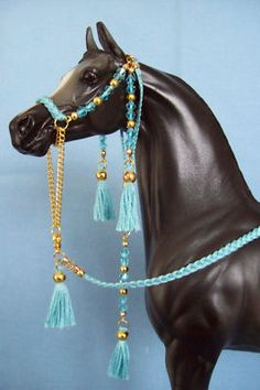 To complete: light blue embroidery thread, gold chain, gold beads, light blue beads