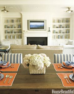 This blue and white family room is a natural extension of the kitchen, incorporating contrasting and complementary colors.