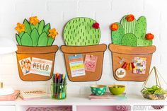 DIY a cute cactus memo board in 3 easy steps! 1) Cut out the shape of a succulent and flowerpot and glue together. 2) Paint your succulent and use a black marker to outline extra detailing. 3) Add floral embellishments as a final touch!