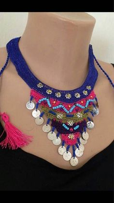 Handcrafted crochet triangle necklace. Blue, pink and green lace with turquose sandbeads. Also small metal acsesories. The back of the collar is adjustable. Made from lace yarn is polyester. The total length of the collie is 70 cm. (27.55 inches) triangle width 25 cm.(9.84 inches)