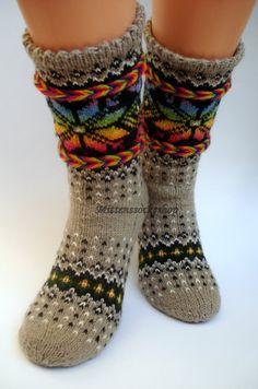 Hand knitted wool socks.Warm socks. Rainbow. Rainbow color pattern on the gray background.Christmas gift idea.