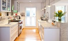 Galley Kitchen done right! Love how open to the Living Spaces it is ...