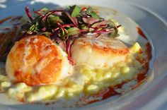 Had the signature dish at Grand Traverse Resort - Scallops with jalapeño buerre blanc and vanilla chorizo oil over corn risotto.  Outstanding!