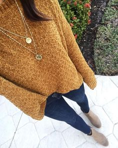 Cute gold oversized sweater with blue jeans.
