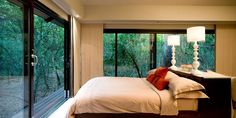 The suites are complemented by exquisite stylish interior decoration and the sumptuous beds dressed in gorgeous bed linen promise an angelic night rest Wilderness Resort, Places Worth Visiting, How To Dress A Bed, Private Games, Game Reserve, Lodges, Beautiful Places, Amazing Places, Places Ive Been