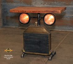 Steampunk Industrial Table / Antique Ford Model T Radiator and Headlamps / Automotive / Barnwood / Table sold Car Part Furniture, Furniture Stores Nyc, Furniture Dolly, Furniture Sale, Discount Furniture, Industrial Table, Industrial Furniture, Rustic Furniture, Metal Furniture