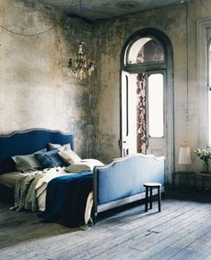 LOVE a weathered wall and high ceilings with pops of color. Absolutely beautiful.