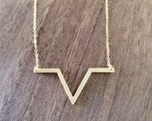 Gold geometric chevron necklace available at https://www.etsy.com/shop/JEMINIshop