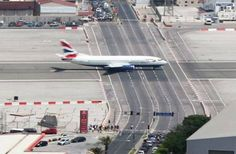 Gibraltar International Airport, Gibraltar-With a major road running through the middle, traffic has to stop for every plane that lands.