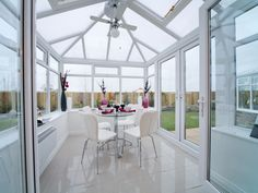 Bring The Outdoors Indoors With A Conservatory Dining Room Thats Flooded Natural Light