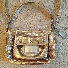 Coach Gold Sequence Purse Gorgeous Gold Coach Sequence Purse. I bought from a fellow Posher & I LOVE it & will keep if not one buys :) NO TRADES! Excellent outside condition - inside does have some pen marks (but who sees that anyways once you put stuff in it...) Coach Bags