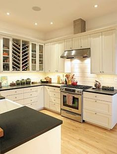 kitchen - light wood floors with black and white