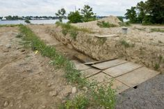 Hart Island, N.Y. Formerly the home of an insane asylum, a quarantine zone, and still a potter's field for New York city's unclaimed dead. Prisoners from Riker's Island are ferried over weekly to bury the dead, a third of which are infants and stillborn children.