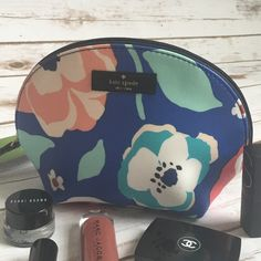 """Kate Spade Floral Cosmetics Case Brand new with tags Kate Spade Make up case. Perfect for your daily purse or travel case. measurement:  7 1/2"""" x 5 1/2"""" x 2 3/4""""  ribbon zipper pull coated canvas satin lining, a card pocket - PRICE FRIM - NO TRADES kate spade Bags Cosmetic Bags & Cases"""