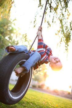 Four year old boy playing on tire swing by Daniel Hurst Photography, via Flickr