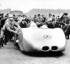 Rudolf Caracciola's car is pushed to the starting line on 28th January 1938 and sent on a record trip.
