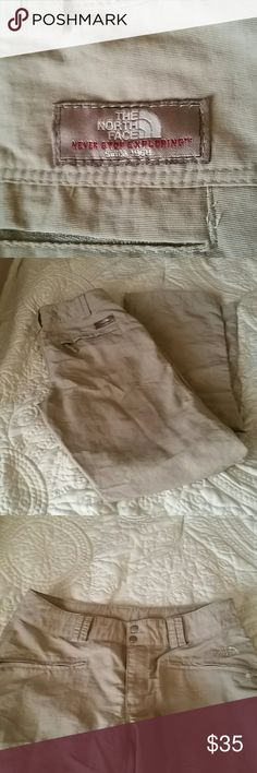 North Face pants Worn twice. Kahki in color. 100% nylon. Slight pilling around back of waist from shirt rubbing. Excellent condition. Please excuse wrinkles but this material wrinkles easily North Face Pants