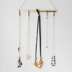 Display your jewelry in a simple, beautiful way with just a few supplies from the hardware store.