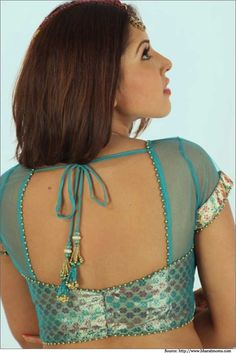 You look won't be completed by choosing a best saree. Choose Best and Latest Blouse Designs to get that sensual look. Check our best Net Blouse Designs now! Blouse Neck Patterns, Blouse Designs High Neck, Netted Blouse Designs, Choli Blouse Design, Fancy Blouse Designs, Designer Blouse Patterns, Bridal Blouse Designs, Dress Designs, Design Patterns