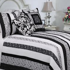 LOVE THIS!!!!!!!!!!@Overstock - Embracing a contemporary look with a delicate floral flair, the Park Avenue Quilt Set offers a variegated striped pattern, embellished with graceful flowers. The set features a sleek black and white colorway for a mix of modern and classic inspirations.http://www.overstock.com/Bedding-Bath/Park-Avenue-Quilt-Set/6811710/product.html?CID=214117 $59.99