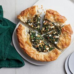 Difficult to pronounce, but oh so easy to make. Simply thaw phyllo dough overnight in the fridge (it collects to much moisture at room temp), and fold Spanakopita Recipe, Moussaka Recipe, Greek Desserts, Greek Recipes, Greek Side Dishes, Main Dishes, Greek Stuffed Peppers, Tzatziki Recipes, Sauteed Greens